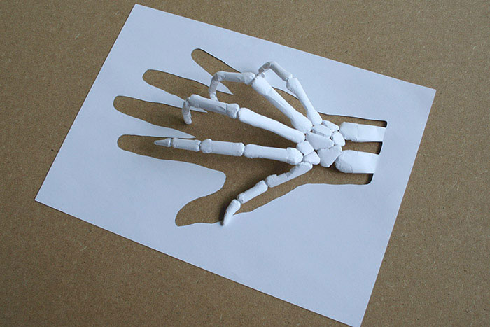 Amazing sculptures cut from a single piece of paper